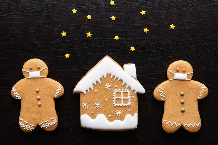 Gingerbread cookies wearing masks